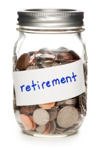 Jar of Coins Labeled Retirement on White