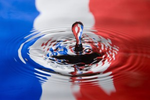 Water droplet against a French flag