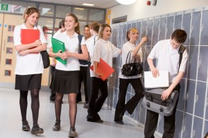 High school students by lockers in the school corridor