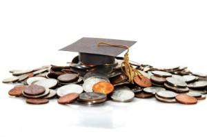 graduation cap  on a pile of money ( student debt )