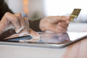 Senior Woman Using Tablet Computer and  credit card, shopping on
