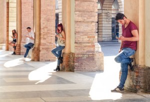 Group of young fashion friends using smartphone in urban old city center - Technology addiction in actual lifestyle with mutual disinterest towards each other - Addicted people to modern mobile phones