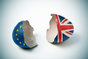 cracked eggshell patterned with the European and the British flag